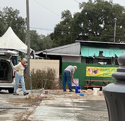 People working on corner lot in Floral City